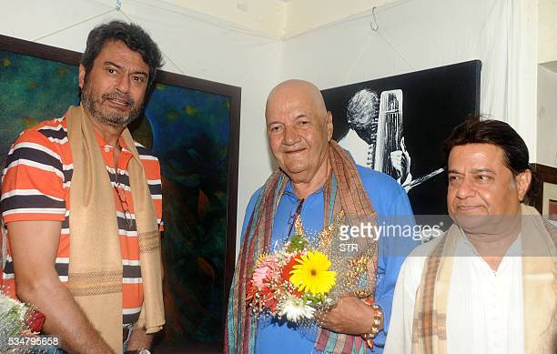 Indian Bollywood film and television actors Kanwaljit Singh Prem Chopra and Bhajan Singer Anup Jalota pose for a photograph at the Indian Art...