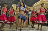 "Indian Bollywood film and television actress Rakhi Sawant poses dances during filming for the forthcoming Hindi film ""Rakhtbeej"" in Mumbai late..."