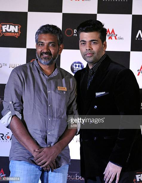 Indian Bollywood film director and producer Karan Johar and writer and director S S Rajamouli attend the trailer launch of upcoming film 'Baahubali'...