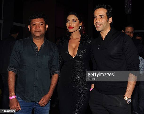 Indian Bollywood film director and screen writer Ken Ghosh and actor Tusshar Kapoor pose for a photograph during the birthday party of model and...