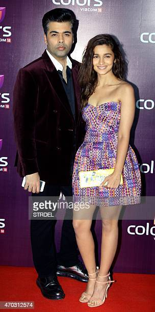 Indian Bollywood film director Karan Johar and actress Alia Bhatt pose for a photograph during a promotional event in Mumbai on late April 18 2015...