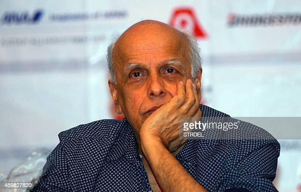 Indian Bollywood film director Mahesh Bhatt looks on during an event to announce the first 'Japan Film Festival Indian 2014' in Mumbai on December 2...