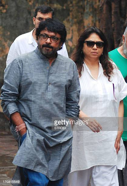 Indian Bollywood film director Sanjay Leela Bhansali with his sister Bela Sehgal arrive to attend the funeral of Ashok Chopra the father of actress...