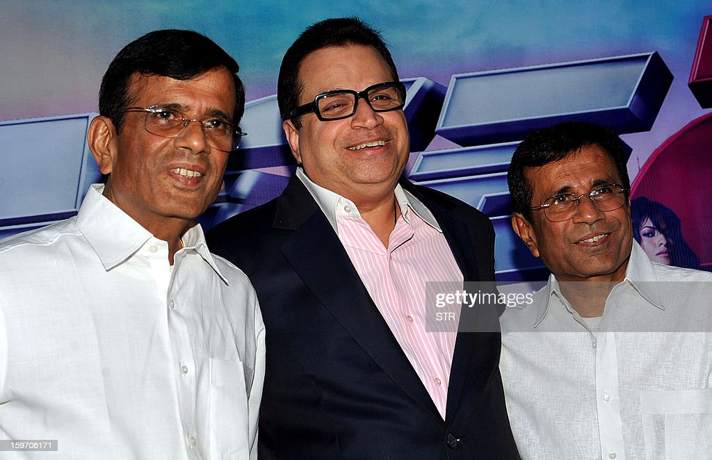 Indian Bollywood film directors Abbas (R), Mustan (L) and producer Ramesh Taurani for Tips Music Company pose during a press meeting for the promotion of upcoming Hindi film 'Race 2' directed by Abbas-Mustan and produced by Ramesh Taurani for Tips Music Company in Mumbai on January 18, 2013. AFP PHOTO