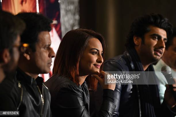 Indian Bollywood film personalities Manoj Bajpai Sonakshi Sinha Arjun Kapoor speaks attend a promotional event for the upcoming Hindi film 'Tevar' in...