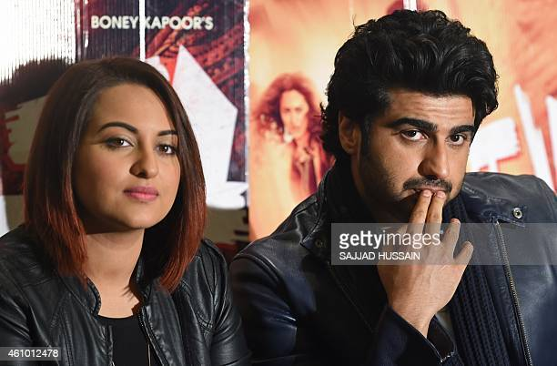 Indian Bollywood film personalities Sonakshi Sinha and Arjun Kapoor attend a promotional event for the upcoming Hindi film 'Tevar' in New Delhi on...