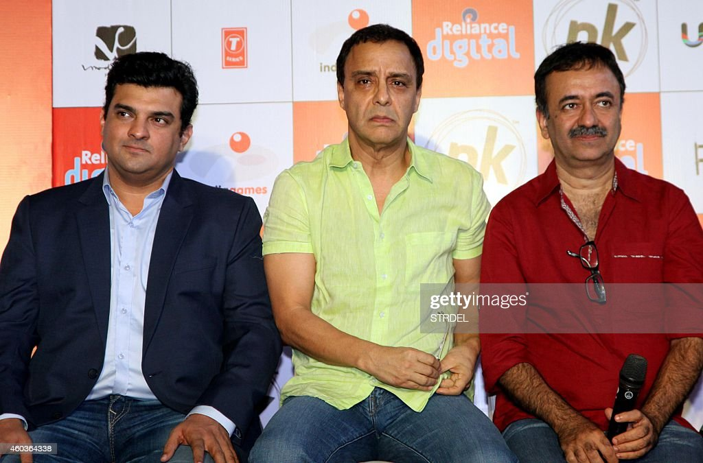 Indian Bollywood film producers (L-R) <a gi-track='captionPersonalityLinkClicked' href=/galleries/search?phrase=Siddharth+Roy+Kapur&family=editorial&specificpeople=6236847 ng-click='$event.stopPropagation()'>Siddharth Roy Kapur</a>, Vidhu Vinod Chopra and director Rajkumar Hirani attend the launch of the official mobile game for their upcoming Hindi film 'PK' in Mumbai on December 12, 2014. AFP PHOTO/STR
