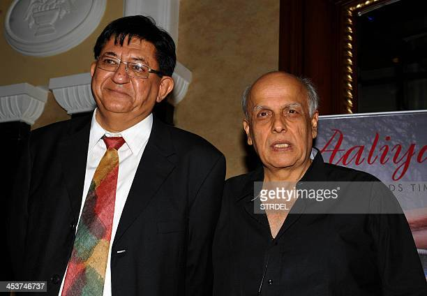 Indian Bollywood Hindi film director Mahesh Bhatt poses with author Rajiv Soni during the launch of the book 'Aaliya' in Mumbai on December 5 2013...