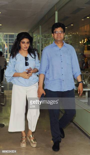Indian Bollywood lyricist Prasoon Joshi and his wife Aparna arrive for a promotional event for Hindi film 'Neerja' in Mumbai on April 15 2017 / AFP...