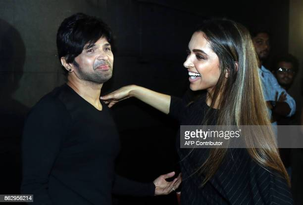 Indian Bollywood music director singer and actor Himesh Reshammiya and Indian actress Deepika Padukone attend the special screening of the upcoming...