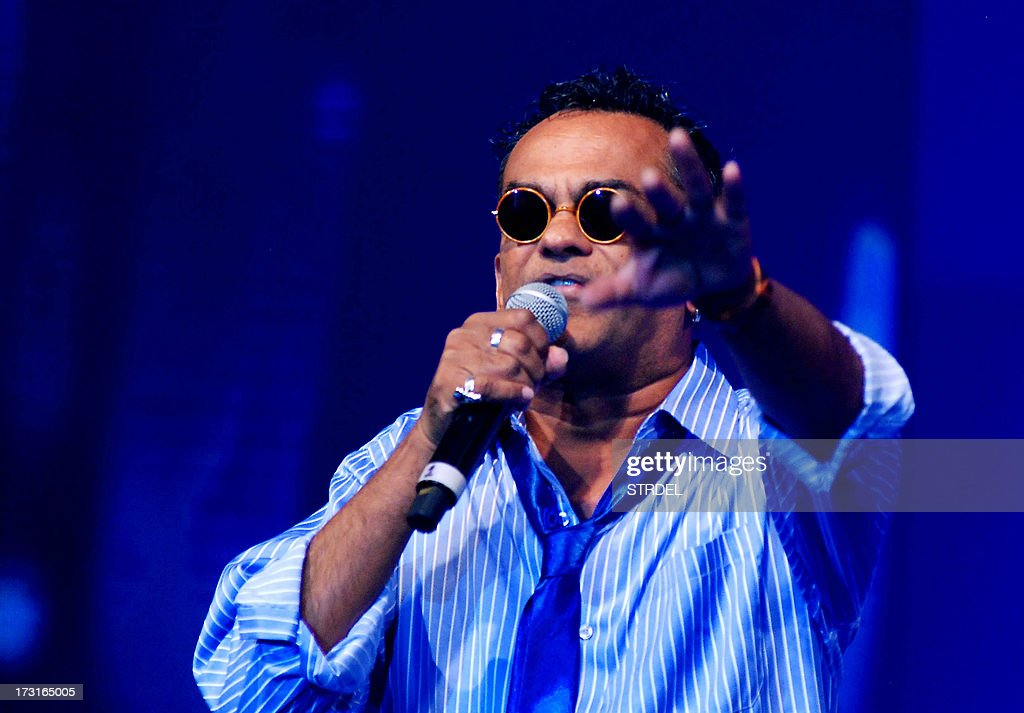 Indian Bollywood musician Remo Fernandes performs during the Tassel Fashion and Lifestyle Awards 2013 in Mumbai late July 8, 2013.