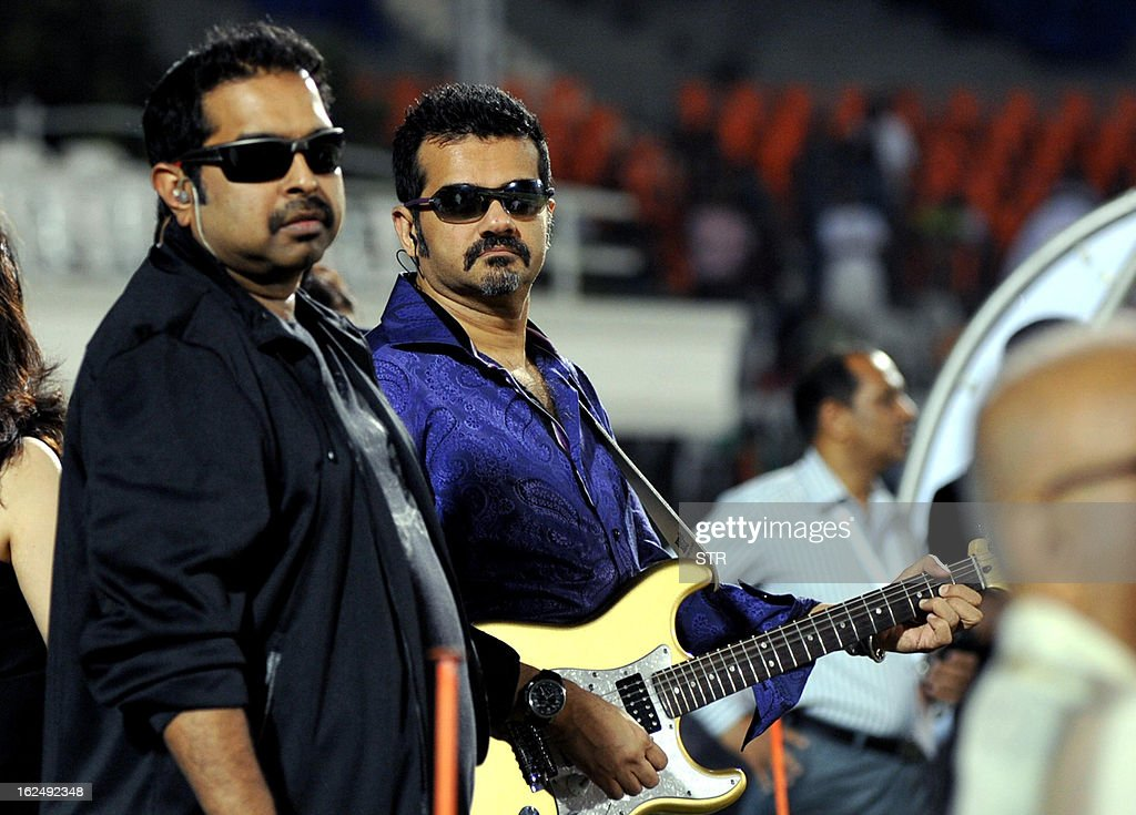 Indian Bollywood musicians and singers Shankar Mahadevan (L) and Ehsaan Noorani prepare to perform during the grand opening ceremony of the Toyota University Cricket Championship (TUCC) first match of the season in Mumbai on February 23, 2013. AFP PHOTO