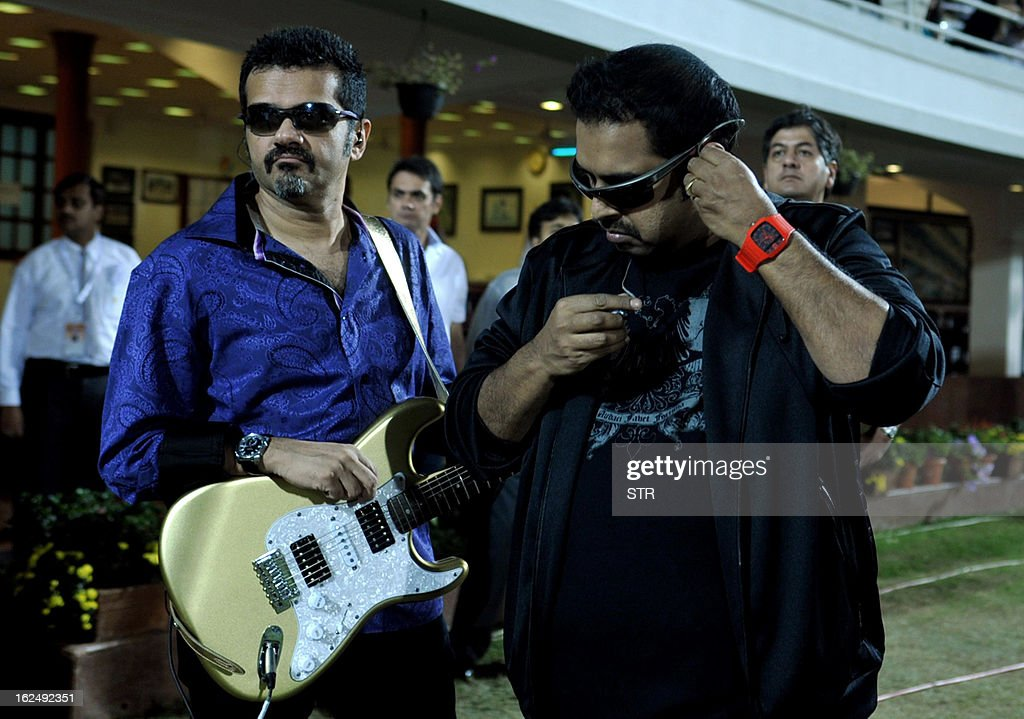 Indian Bollywood musicians and singers Shankar Mahadevan (R) and Ehsaan Noorani prepare to perform during the grand opening ceremony of the Toyota University Cricket Championship (TUCC) first match of the season in Mumbai on February 23, 2013. AFP PHOTO