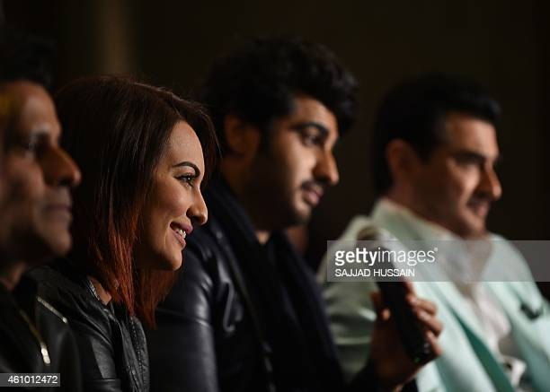 Indian Bollywood personalities Manoj Bajpai Sonakshi Sinha Arjun Kapoor and Sanjay Kapoor speak with the media during a promotional event for the...