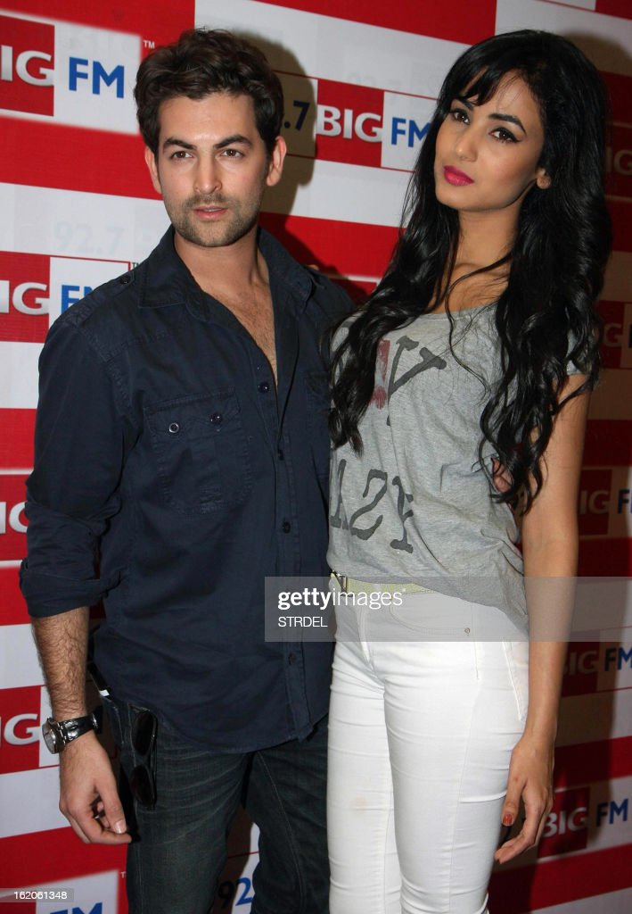 Indian Bollywood personalities Neil Nitin Mukesh (L) and Sonal Chauhan pose during a promotional event for the horror thriller Hindi Film '3G' outside a radio station in Mumbai on February 18, 2013.