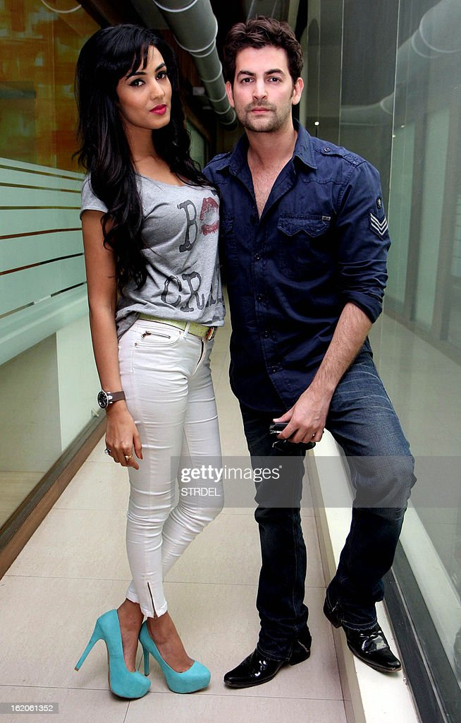 Indian Bollywood personalities Neil Nitin Mukesh (R) and Sonal Chauhan pose during a promotional event for the horror thriller Hindi Film '3G' outside a radio station in Mumbai on February 18, 2013. AFP PHOTO