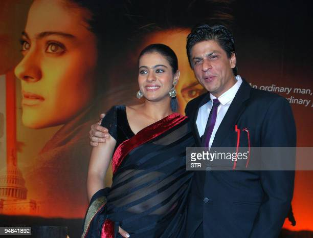 Indian Bollywood personalities Shahrukh Khan and Kajol pose during a first look screening for the movie 'My Name is Khan' in Mumbai on December 16...