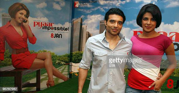 Indian Bollywood personalities Uday Chopra and Priyanka Chopra pose during a promotional event for the Hindi movie �Pyaar Impossible� at Yashraj...