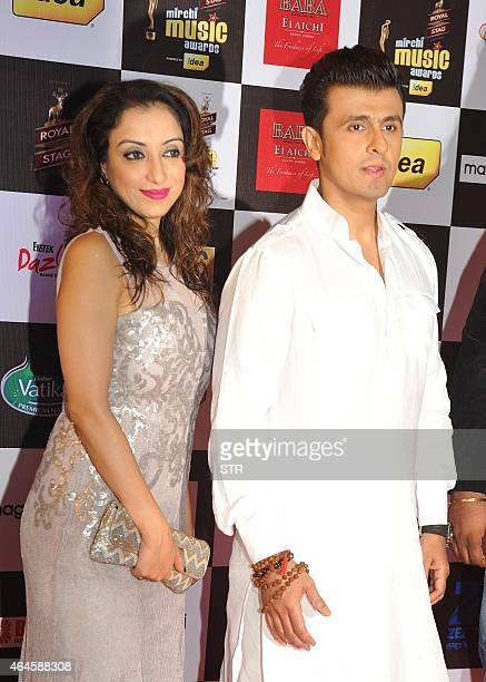 Indian Bollywood play back singer Sonu Nigam and his wife attend the 'Mirchi Music Awards 2015' ceremony in Mumbai on February 26 2015 AFP PHOTO