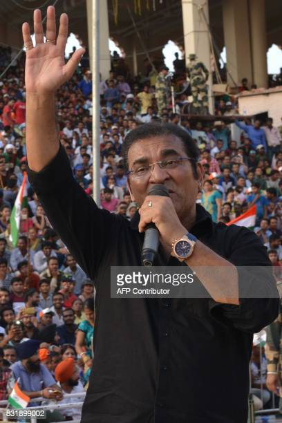 Indian bollywood playback singer Abhijeet Bhattacharya performs during a ceremony to mark India's 70th Independence Day celebrations at the...