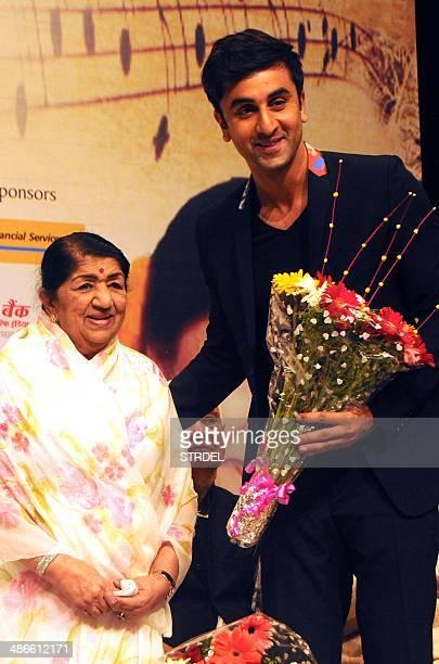 Indian Bollywood playback singer Lata Mangeshkar and actor Ranbir Kapoor pose for a photograph during the '72nd Master Deenanath Mangeshkar Awards'...