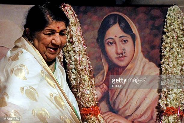 Indian Bollywood playback singer Lata Mangeshkar attends the Master Dinanath Mangeshkar 71st Birth Anniversary Awards Ceremony in Mumbai April 24...