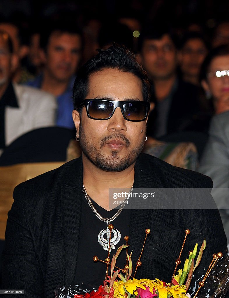 Indian Bollywood playback singer Mika Singh looks on during a panel discussion for Save & Empower The Girl Child in Mumbai late February 5, 2014.