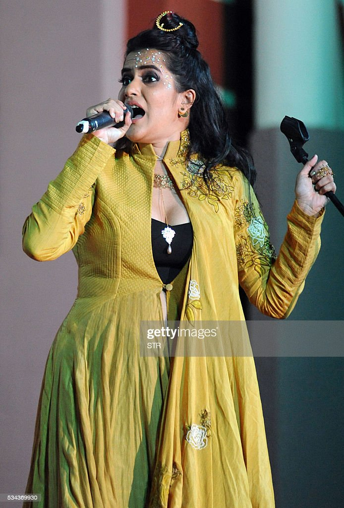 Indian Bollywood playback singer, music composer and lyricist Sona Mohapatra performs during the 'Kashish Mumbai International Queer Film Festival 2016', South Asia's biggest LGBT film festival in Mumbai on late May 25, 2016. / AFP / STR