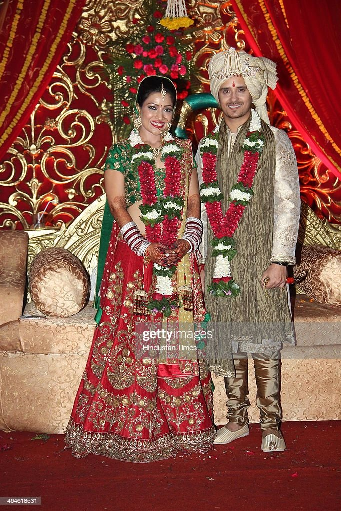 Indian Bollywood playback singer Raghav Sachar and actor Amita Pathak during their wedding reception on January 21, 2014 in Mumbai, India.