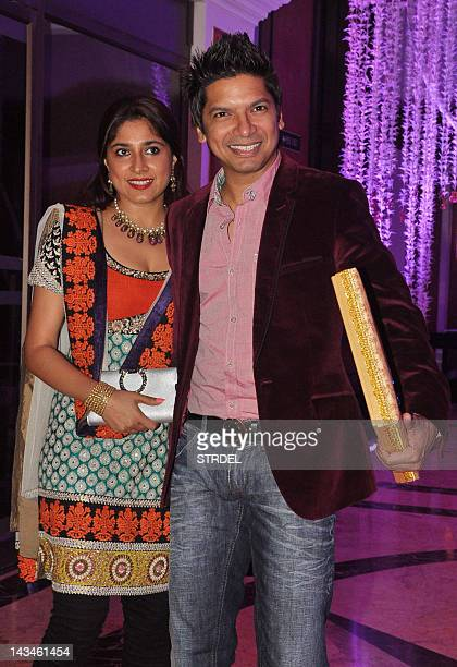 Indian Bollywood playback singer Shaan with wife attend the wedding reception of playback singer Sunidhi Chauhan and musician Hitesh Sonik during in...