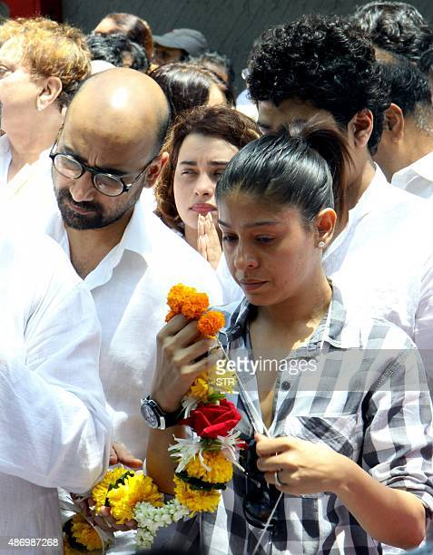 Indian Bollywood playback singer Sunidhi Chauhan with her husband music composer Hitesh Sonik attend the funeral of the late Bollywood music composer...