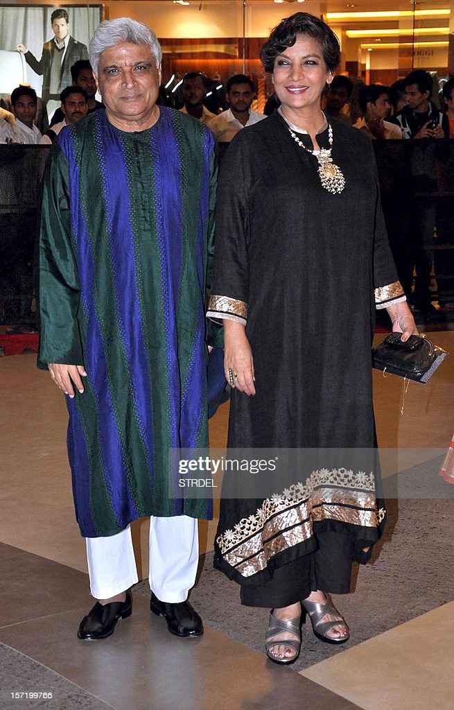 "Indian Bollywood poet, lyricist and scriptwriter Javed Akhtar (L) poses with his wife actress Shabana Azmi pose as they arrive to attend the premier of Hindi film ""Talaash"" directed by Reema Kagti in Mumbai late November 29, 2012. Bollywood superstar Aamir Khan is back on the Indian big screen on November 30, in his first commercial film release for three years, taking up the role of a mustachioed police inspector in a Mumbai crime thriller."