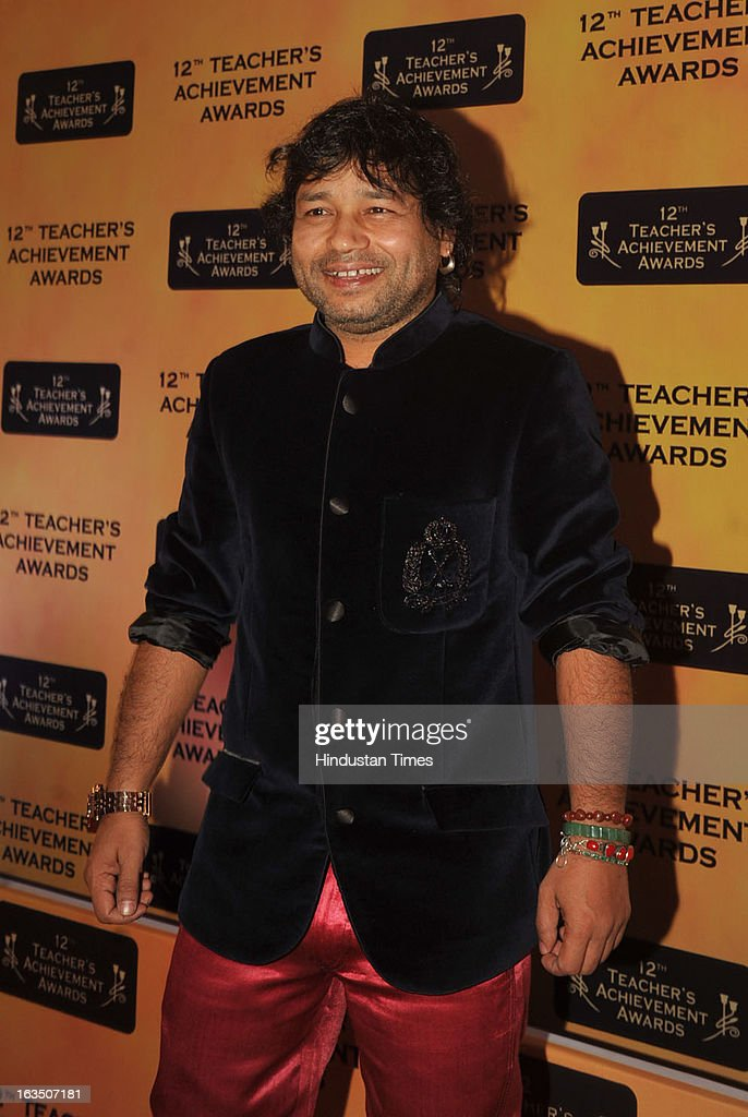 Indian bollywood pop-rock singer <a gi-track='captionPersonalityLinkClicked' href=/galleries/search?phrase=Kailash+Kher&family=editorial&specificpeople=5976006 ng-click='$event.stopPropagation()'>Kailash Kher</a> during the 12th Teachers Achievement Awards 2013 at the Hotel Taj Lands End, Bandra on March 9, 2013 in Mumbai,India.