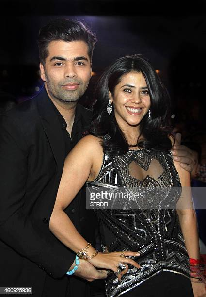 Indian Bollywood producer and director Karan Johar and Ekta Kapoor pose as they attend the BIG STAR Entertainment Awards 2014 in Mumbai on December...