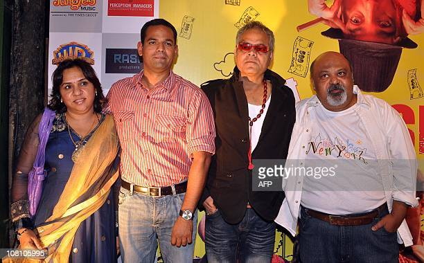 Indian bollywood producer Aparna Joshi Director Srikanth V Velagaleti and actors Sanjay Sharma and Saurabh Shukla pose as they attend the promotional...