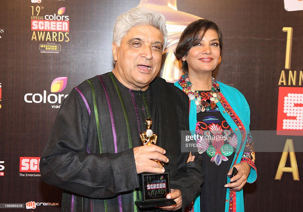 Indian Bollywood scriptwriter Javed Akhtar with wife actress Shabana Azmi during the 19th annual Colors Screen Awards in Mumbai on January 12, 2013.
