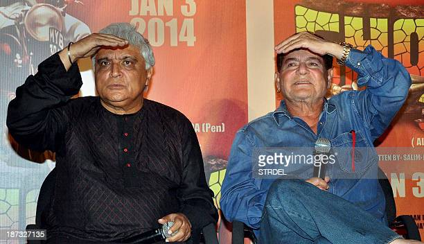 Indian Bollywood scriptwriters Javed Akhtar and Salim Khan look on during a promotional event for the film Sholay which has been rereleased in 3D in...