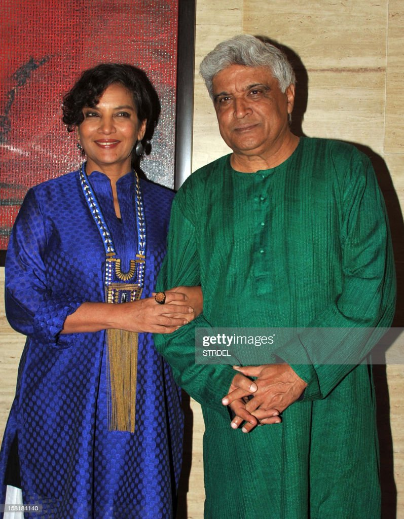 Indian Bollywood scripwriter Javed Akhtar with wife actress Shabana Azmi pose during a party event for the Hindi film 'Talaash' in Mumbai on December 10, 2012.