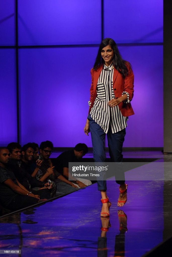Indian Bollywood Singer Anushka Manchanda walks the ramp during the Blackberrys Sharp Night Fashion Show at Mehboob studio, Bandra on May 3, 2013 in Mumbai, India. The Blackberrys Sharp Night is a fashion show organised by Blackberrys to showcase their new Summer/Spring collection.