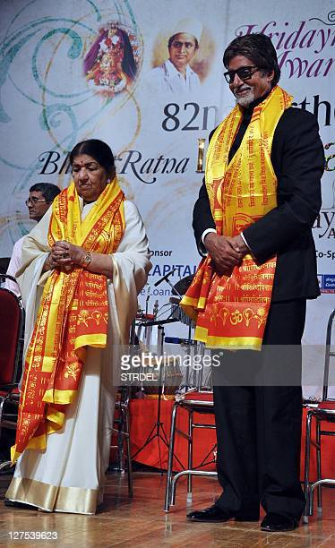 Indian Bollywood singer Lata Mangeshkar poses with actor Amitabh Bachchan during celebrations for her 82nd birthday in Mumbai late September 28 2011...