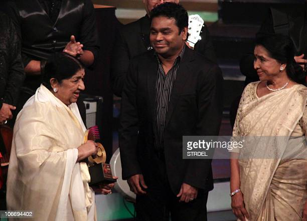 Indian Bollywood singer Lata Mangeshkar receives the Lifetime Achievement award by Indian film composer AR Rahman and Indian singer Asha Bhosle at...