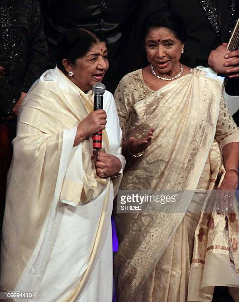 Indian Bollywood singer Lata Mangeshkar speaks after receiving the Lifetime Achievement award by Indian film composer AR Rahman and Indian singer...