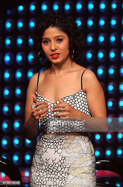 Indian Bollywood singer Sunidhi Chauhan appears as a judge during the unveiling of the television reality music show 'The Voice India' in Mumbai on...