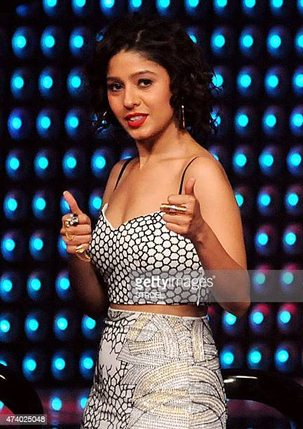Indian Bollywood singer Sunidhi Chauhan gestures as she prepares to judge participants in the reality music television show The Voice India in Mumbai...