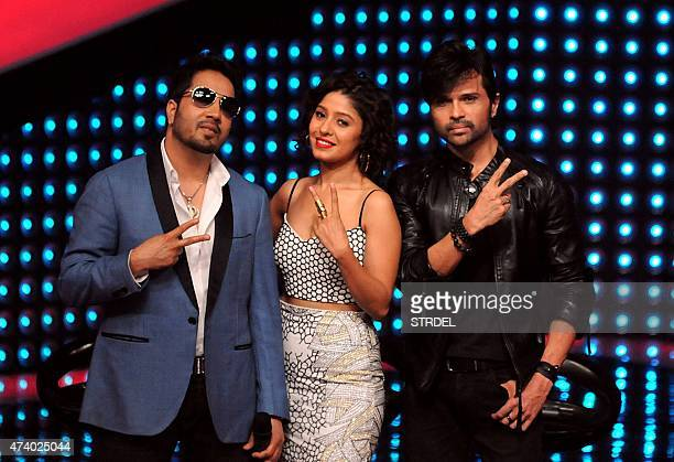 Mika Singh Sunidhi Chauhan and Himesh Reshammiya prepare to judge participants in the reality music television show The Voice India in Mumbai late...