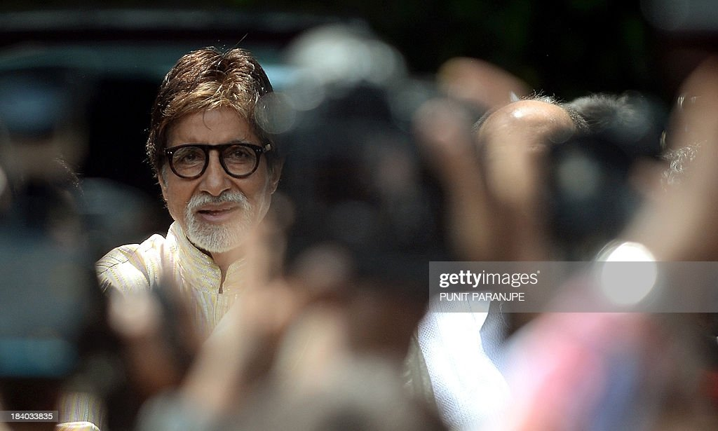 Indian Bollywood star Amitabh Bachchan waves towards fans gathered outside his residence on his 71st birthday in Mumbai on October 11, 2013. India's favourite film star and Bollywood legend, Bachchan - who is known as the 'The Big B' and has over 3.5 million Twitter followers is treated like royalty in the movie-mad country.
