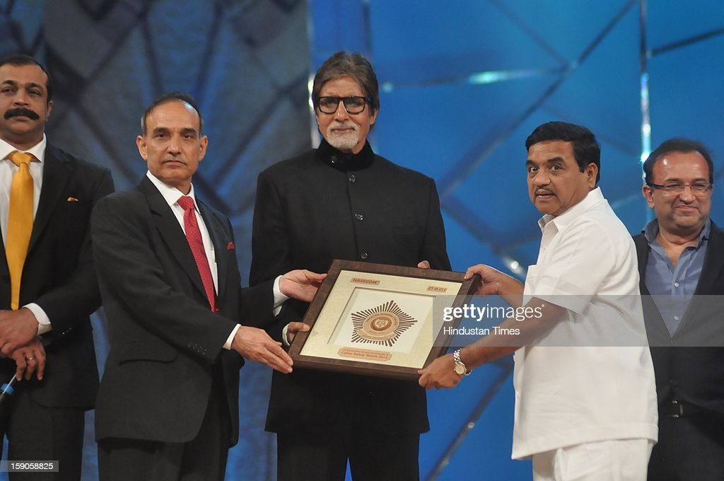 Indian bollywood superstar Amitabh Bachchan felicitated by Mumbai police commissioner Satyapal Singh (L) and Maharashtra Home Minister RR Patil (R) during the Umang Mumbai Police Annual Show 2013 at Andheri Sports Complex on January 5, 2013 in Mumbai, India.