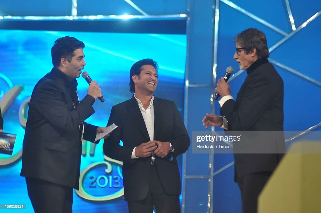 Indian bollywood superstar Amitabh Bachchan with Indian Cricketer Sachin Tendulkar and producer, director Karan Johar during the Umang Mumbai Police Annual Show 2013 at Andheri Sports Complex on January 5, 2013 in Mumbai, India.