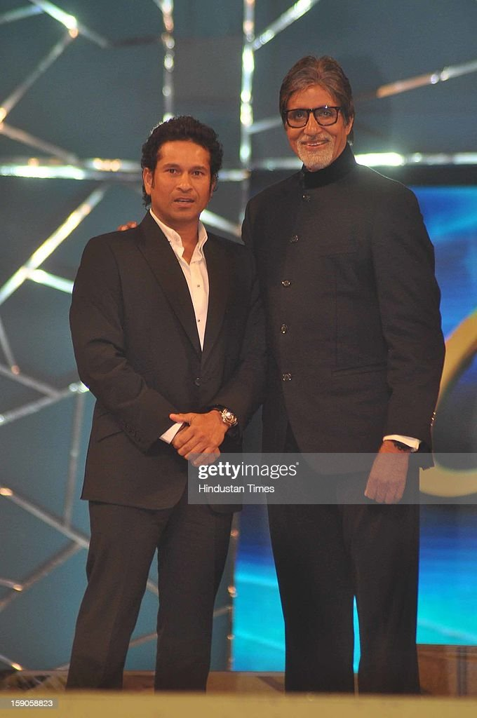 Indian bollywood superstar Amitabh Bachchan with Indian Cricketer Sachin Tendulkar during the Umang Mumbai Police Annual Show 2013 at Andheri Sports Complex on January 5, 2013 in Mumbai, India.