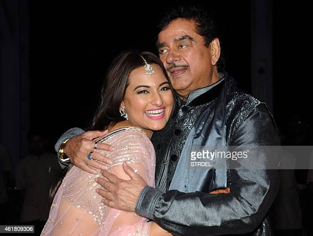 Indian Bollywood veteran actor Shatrughan Sinha with his daughter Sonakshi Sinha attend the wedding reception of his son Kussh Sinha and Taruna...